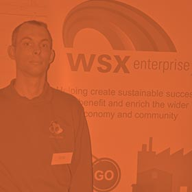 Dean Packer, owner of Events R Me, standing by WSX Enterprise sign