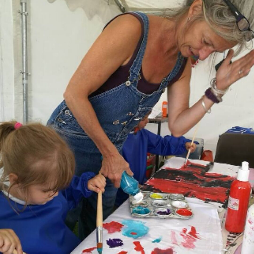 Connie with paints at an event