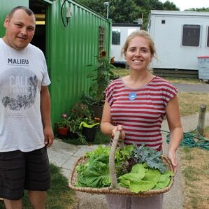 Volunteers showing off veg grown at The Project in Wickham